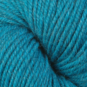 Skein of Berroco Ultra Alpaca Worsted weight yarn in the color Carribean Mix (Blue) for knitting and crocheting.