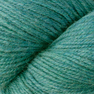 Skein of Berroco Ultra Alpaca Worsted weight yarn in the color Turquoise Mix (Blue) for knitting and crocheting.