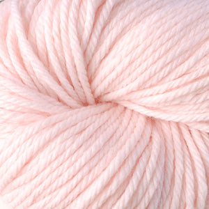 Skein of Berroco Vintage Chunky Bulky weight yarn in the color Fondant (Pink) for knitting and crocheting.