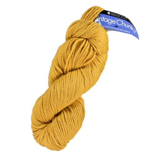 Skein of Berroco Vintage Chunky Bulky weight yarn in the color Sunny (Yellow) for knitting and crocheting.