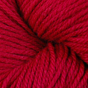 Skein of Berroco Vintage DK DK weight yarn in the color Cardinal (Red) for knitting and crocheting.