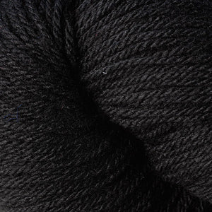 Skein of Berroco Vintage DK DK weight yarn in the color Cast Iron (Black) for knitting and crocheting.