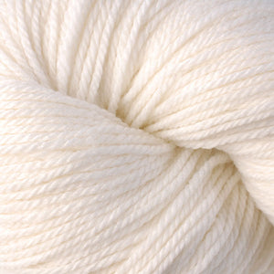 Skein of Berroco Vintage DK DK weight yarn in the color Mochi (White) for knitting and crocheting.