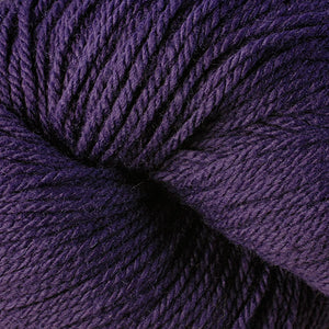 Skein of Berroco Vintage DK DK weight yarn in the color Petunia (Purple) for knitting and crocheting.