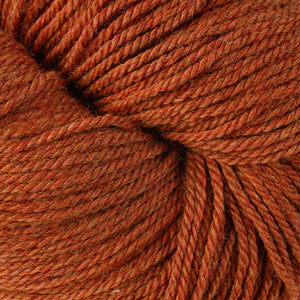 Skein of Berroco Vintage DK DK weight yarn in the color Pumpkin (Orange) for knitting and crocheting.