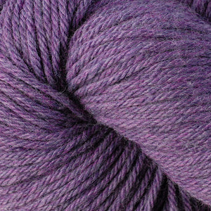 Skein of Berroco Vintage Worsted weight yarn in the color Lilacs (Purple) for knitting and crocheting.