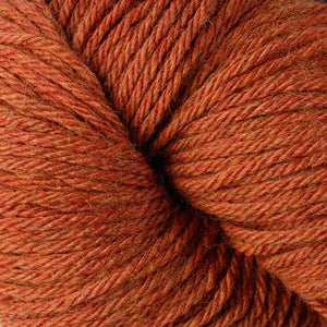 Skein of Berroco Vintage  Worsted weight yarn in the color Pumpkin (Orange) for knitting and crocheting.