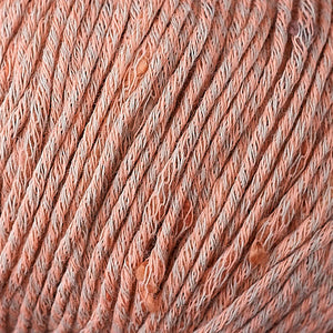 Skein of Berroco Zinnia Worsted weight yarn in color Peach Cobbler (Orange) for knitting and crocheting.
