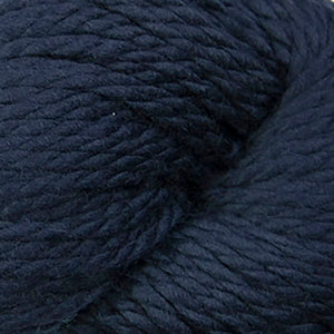 Skein of Cascade 128 Superwash Bulky weight yarn in the color Navy (Blue) for knitting and crocheting.