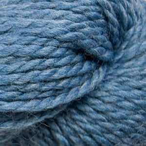 Skein of Cascade 128 Superwash Bulky weight yarn in the color Sapphire (Blue) for knitting and crocheting.