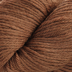 Skein of Cascade 220  weight yarn in the color Carob Brown (Brown) for knitting and crocheting.