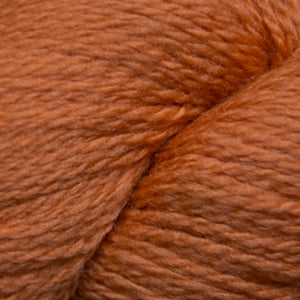 Skein of Cascade 220 Fingering Sock weight yarn in the color Amber Glow (Orange) for knitting and crocheting.