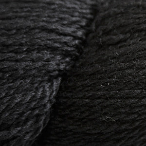 Skein of Cascade 220 Fingering Sock weight yarn in the color Black (Black) for knitting and crocheting.