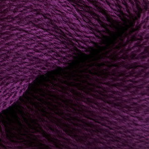 Skein of Cascade 220 Fingering Sock weight yarn in the color Dark Plum (Purple) for knitting and crocheting.