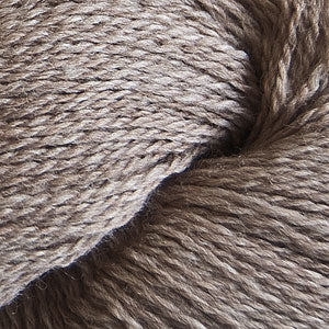 Skein of Cascade 220 Fingering Sock weight yarn in the color Doeskin Heather (Brown) for knitting and crocheting.