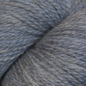 Skein of Cascade 220 Fingering Sock weight yarn in the color Indigo Frost Heather (Blue) for knitting and crocheting.