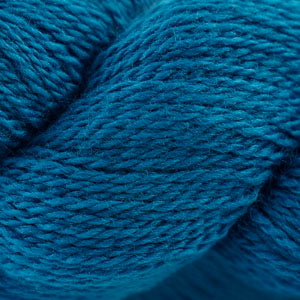 Skein of Cascade 220 Fingering Sock weight yarn in the color Midnight (Blue) for knitting and crocheting.