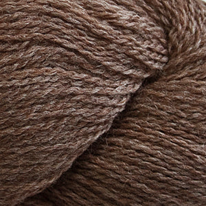 Skein of Cascade 220 Fingering Sock weight yarn in the color Walnut Heather (Brown) for knitting and crocheting.