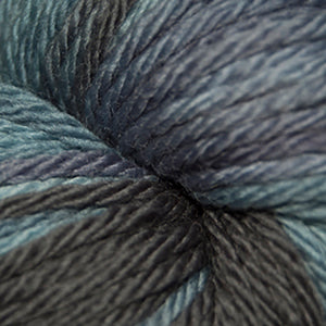 Skein of Cascade 220 Superwash Sport Multis Sport weight yarn in the color Denim (Blue) for knitting and crocheting.