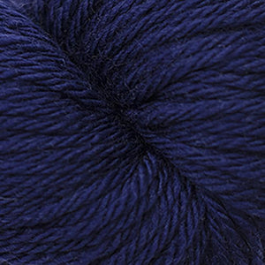 Skein of Cascade 220 Superwash Sport Sport weight yarn in the color Blue Depths (Blue) for knitting and crocheting.