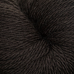 Skein of Cascade 220 Superwash Sport Sport weight yarn in the color Chocolate (Brown) for knitting and crocheting.