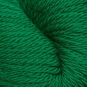 Skein of Cascade 220 Superwash Sport Sport weight yarn in the color Christmas Green (Green) for knitting and crocheting.