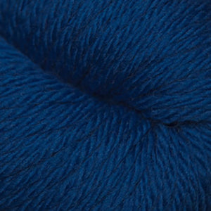 Skein of Cascade 220 Superwash Sport Sport weight yarn in the color Classic Blue (Blue) for knitting and crocheting.