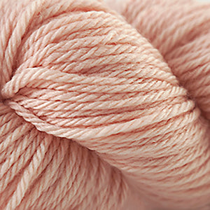 Skein of Cascade 220 Superwash Sport Sport weight yarn in the color Cream Puff (Orange) for knitting and crocheting.
