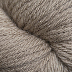 Skein of Cascade 220 Superwash Sport Sport weight yarn in the color Extreme Creme Cafe (Tan) for knitting and crocheting.