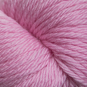 Skein of Cascade 220 Superwash Sport Sport weight yarn in the color Pink Ice (Pink) for knitting and crocheting.