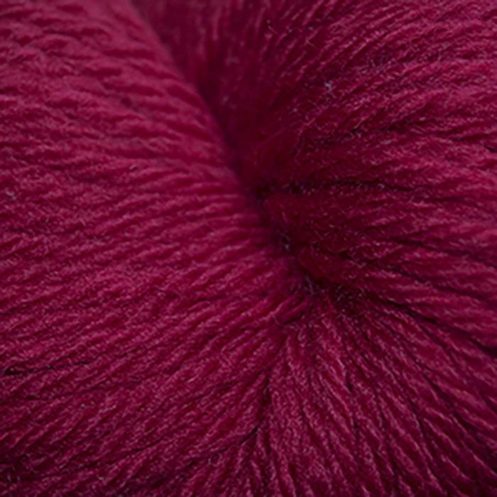 Skein of Cascade 220 Superwash Sport Sport weight yarn in the color Really Red (Red) for knitting and crocheting.