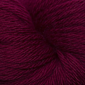Skein of Cascade 220 Superwash Sport Sport weight yarn in the color Ruby (Red) for knitting and crocheting.