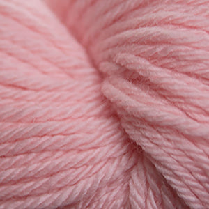 Skein of Cascade 220 Superwash Sport Sport weight yarn in the color Salmon (Pink) for knitting and crocheting.