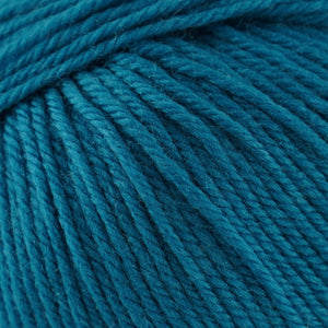 Skein of Cascade 220 Superwash Worsted weight yarn in the color Blue Sapphire (Blue) for knitting and crocheting.