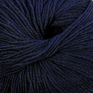 Skein of Cascade 220 Superwash Worsted weight yarn in the color Navy (Blue) for knitting and crocheting.
