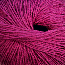 Load image into Gallery viewer, Skein of Cascade 220 Superwash Worsted weight yarn in the color Raspberry (Pink) for knitting and crocheting.