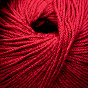 Skein of Cascade 220 Superwash Worsted weight yarn in the color Really Red (Red) for knitting and crocheting.