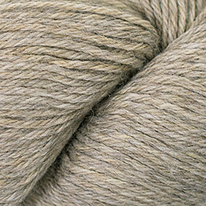 Skein of Cascade 220 Worsted weight yarn in the color Fog Hatt (Tan) for knitting and crocheting.
