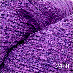 Skein of Cascade 220 Worsted weight yarn in the color Heather (Purple) for knitting and crocheting.