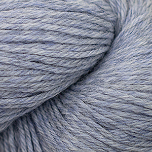 Skein of Cascade 220 Worsted weight yarn in the color Indigo Frost Heather (Gray) for knitting and crocheting.