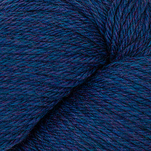 Skein of Cascade 220 Worsted weight yarn in the color Lapis Heather (Blue) for knitting and crocheting.