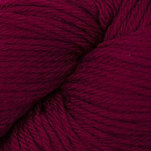 Skein of Cascade 220 Worsted weight yarn in the color Ruby (Red) for knitting and crocheting.