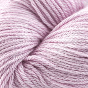 Skein of Cascade 220 Worsted weight yarn in the color Soft Pink (Pink) for knitting and crocheting.