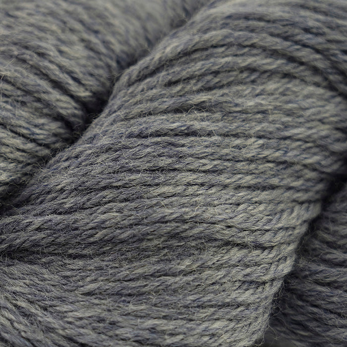 Skein of Cascade 220 Worsted weight yarn in the color Storm Cloud Heather (Gray) for knitting and crocheting.