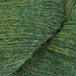 Skein of Cascade Alpaca Lace Lace weight yarn in the color Icelander (Green) for knitting and crocheting.