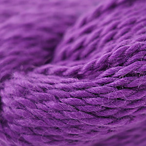 Skein of Cascade Baby Alpaca Chunky Bulky weight yarn in the color Grape Juice (Purple) for knitting and crocheting.