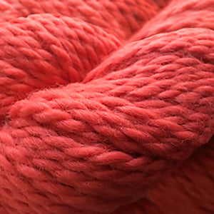 Skein of Cascade Baby Alpaca Chunky Bulky weight yarn in the color Poppy Red (Red) for knitting and crocheting.