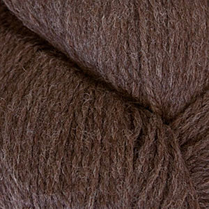 Skein of Cascade Ecological Wool Bulky weight yarn in the color Chocolate (Brown) for knitting and crocheting.