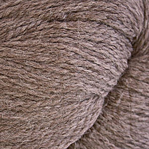 Skein of Cascade Ecological Wool Bulky weight yarn in the color Latte (Brown) for knitting and crocheting.