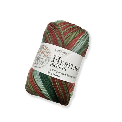 Skein of Cascade Heritage Prints Sock weight yarn in the color Holidaze Stripe (Red & Green) for knitting and crocheting.